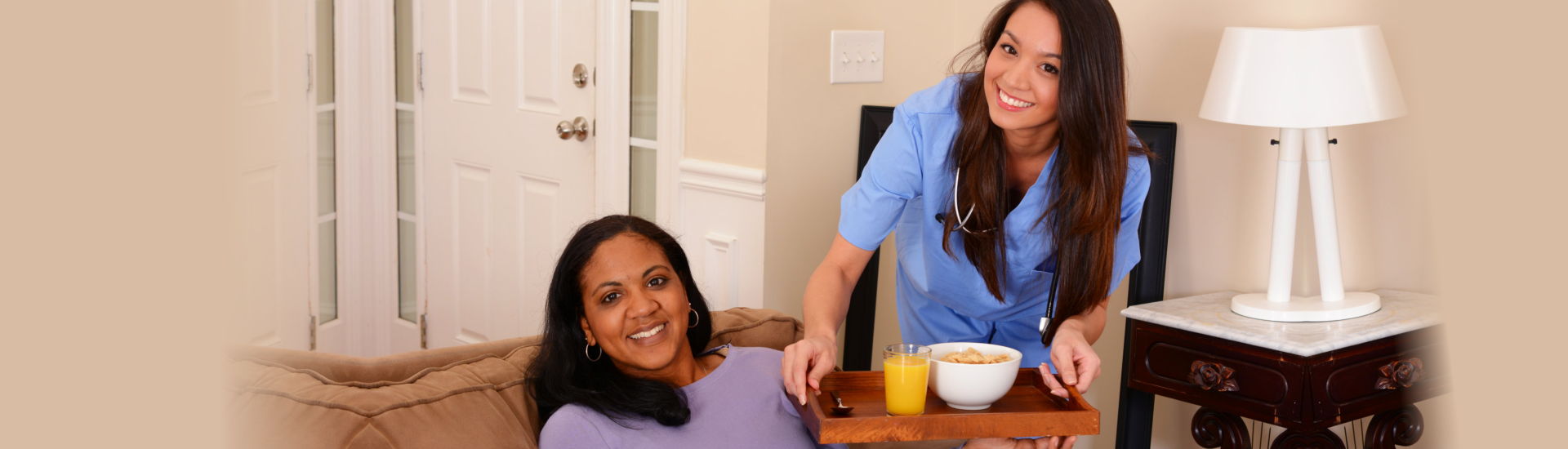 caregiver giving breakfast to a woman