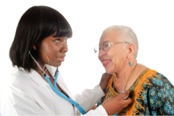 Nurse checking the heartbeat of old woman